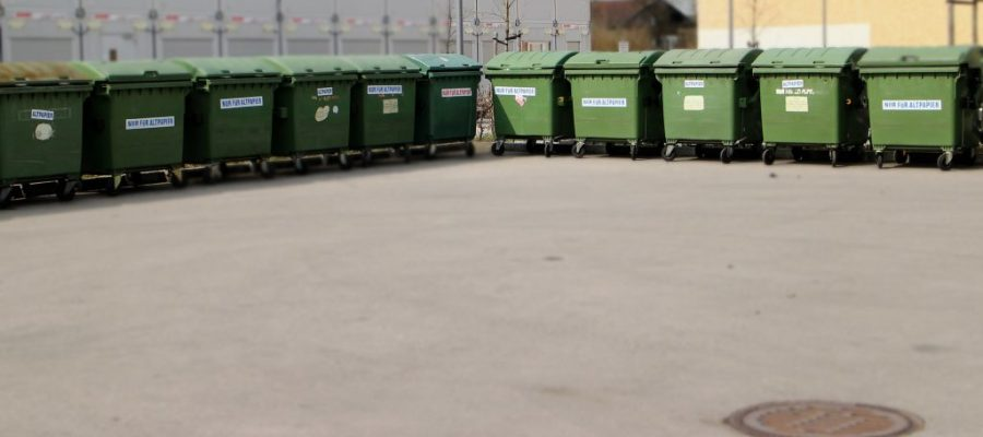 How can businesses implement an effective waste management plan